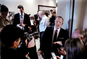 Sean Spicer surrounded by reporters