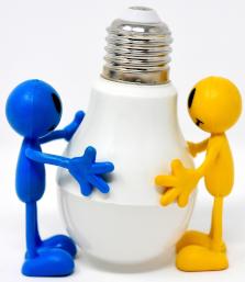 little rubber people hugging LED bulb